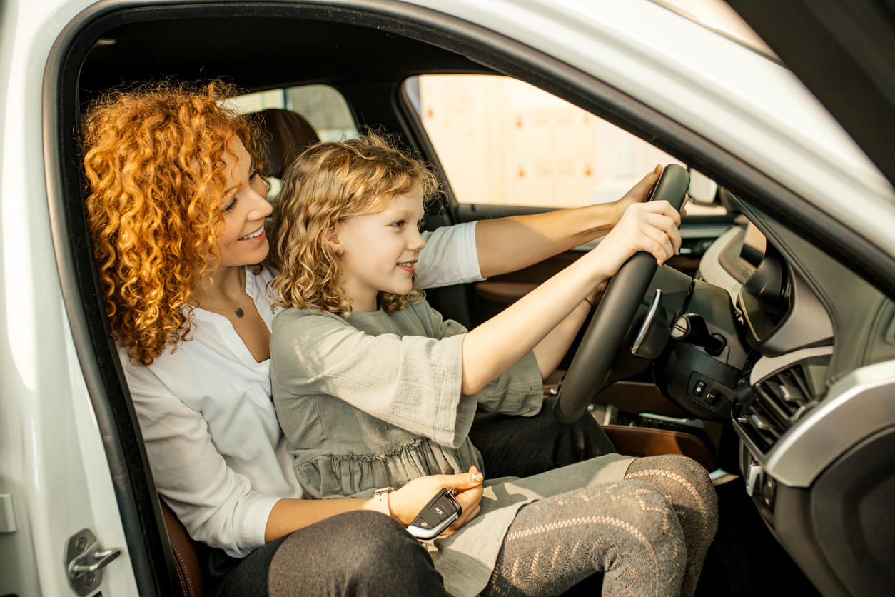 Mom and daughter looking at used cars to lease